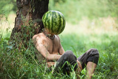 Boy with a watermelon instead of head Stock Images