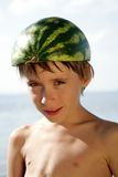 Boy with watermelon helmet Stock Photo