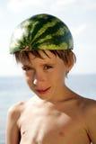 Boy with watermelon helmet Stock Photo