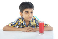 Boy with watermelon juice Stock Image