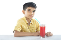 Boy with watermelon juice Royalty Free Stock Photos