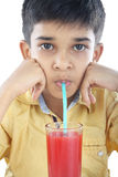 Boy with watermelon juice Stock Images