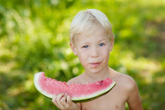 Boy with watermelon. Little boy holding a watermelon in his hands Royalty Free Stock Photos