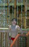 Boy in the waterpark. Young smiling boy in the waterpark Royalty Free Stock Photography