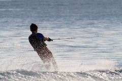 Boy on waterski. Towed by a boat, out of frame Stock Photography