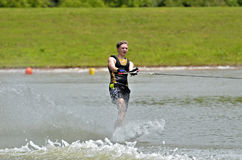 Boy Waterskiing. A teen boy on slalom ski stock photo