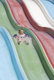 The boy on a waterslide. Stock Photography
