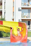 Boy on a waterslide Royalty Free Stock Photography
