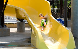 Boy on a Waterslide Stock Photo
