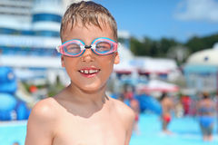 Boy in watersport goggles near pool in aquapark Royalty Free Stock Photography