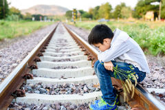 Boy wating on the railway Royalty Free Stock Photo