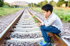 Boy wating on the railway Royalty Free Stock Image