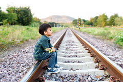 Boy wating on the railway Stock Image