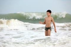 Boy in waves in ocean Stock Image