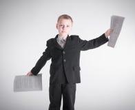 Boy waving bundles of paper Stock Photos
