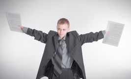 Boy waving papers Royalty Free Stock Photography