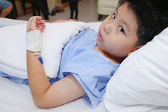 Boy wear patient suit  in hospital bed Stock Images