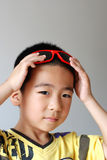 Boy wear sunglasses Stock Photo
