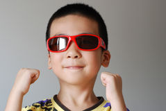 Boy wear sunglasses Stock Photos