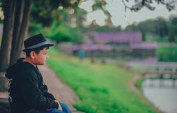 Boy Wearing Black Zip-up Hoodie And Black Fedora Hat royalty free stock photography