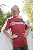 Boy Wearing Cape And Swimming Goggles Stock Photo