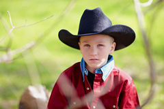 Boy wearing cowboy hat. Portrait of a young boy wearing a black cowboy hat Royalty Free Stock Image