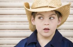 Boy Wearing a Cowboy Hat Looks Left Royalty Free Stock Photos