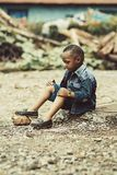 Boy Wearing Denim Jacket and Shorts With Pair of Shoes Royalty Free Stock Photography