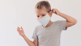 Boy wearing facial disposable mask. Stop coronavirus