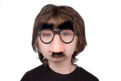 Boy wearing fake nose and glas Royalty Free Stock Photography