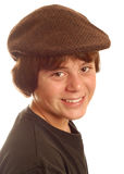 Boy wearing flat cap Stock Images