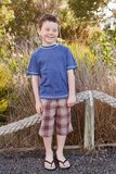 Boy wearing flip flops Stock Photography