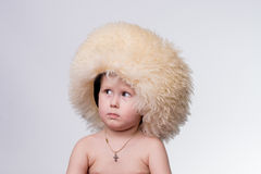 Boy wearing funny furry winter hat Royalty Free Stock Images