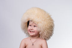 Boy wearing funny furry winter hat Royalty Free Stock Photography