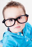 Boy wearing glasses Stock Photos