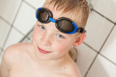 Boy wearing goggles in the shower Royalty Free Stock Photo