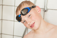 Boy wearing goggles in the shower Royalty Free Stock Photography