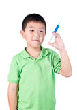 A boy wearing green t-shirt, holding syringe in his hand Royalty Free Stock Photos