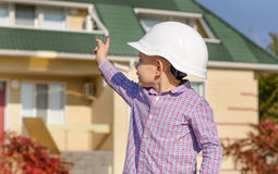 Boy Wearing Hard Hat Presenting Finished House Stock Photos