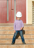 Boy Wearing Hard Hat Standing on Stairs Royalty Free Stock Photo