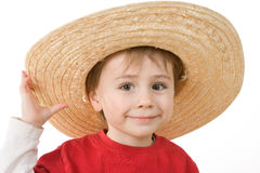 Boy wearing a hat. Young boy wearing a large straw wide-brim hat.  Isolated against a white background Stock Photography