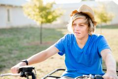 Boy riding farm truck in vineyard royalty free stock image