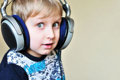 Boy wearing headphones stock image