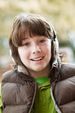Boy Wearing Headphones And Listening To Music Stock Photo