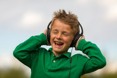 Boy wearing headphones Stock Photos