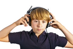 Boy is wearing headphones and listens to the music Stock Images