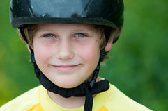 Boy wearing a helmet. Close up of a young boy outdoors wearing a helmet Royalty Free Stock Photography