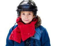 Boy wearing a hocky helmet. Closeup of a six year old boy outdoors in winter wearing a hockey helmet Stock Image