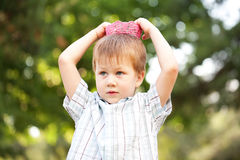 Boy wearing a knitted crown Royalty Free Stock Photos
