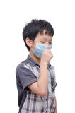 Boy wearing mask over white Stock Images